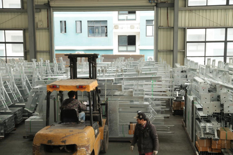 light steel building factory workers.jpg